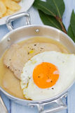 Fried meat with sauce and fried egg Stock Photo