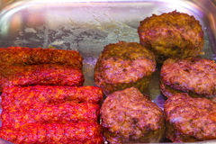 Fried meat sausages and burgers Stock Image