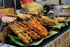 Fried meat with sticks, street food market in Vietnam, Ho Chi Minh city Royalty Free Stock Photos