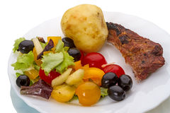 Fried meat and vegetable salad Royalty Free Stock Photography