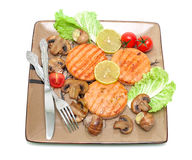 Fried medallions of salmon, stuffed snails with mushrooms and ve Stock Image