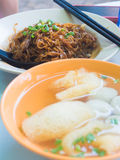 Fried  Mee with fish ball soup. Royalty Free Stock Images