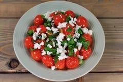 Fried Mini Tomatoes och smaktillsatser som kryddas med persilja- och Fetaost Royaltyfria Foton