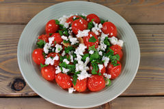 Fried Mini Tomatoes and seasonings, seasoned with parsley and Feta Cheese Royalty Free Stock Photos