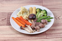 Fried mixed vegetables with chicken hearts-gizzard-liver. Stock Image