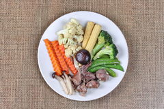 Fried mixed vegetables with chicken hearts-gizzard-liver. Stock Photography