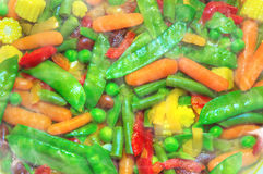 Fried mixed vegetables with steam. Hot aroma kitchen. Vegetarian mixture close-up. top view Stock Images