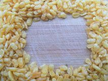 Fried Moong dal frame on wooden background Stock Image