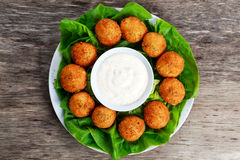 Fried mozzarella cheese stick balls with white sauce Royalty Free Stock Images