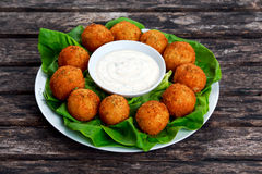 Fried mozzarella cheese stick balls with white sauce Stock Photography