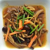 Fried mushroom with oyster sauce Stock Image