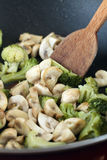 Fried mushrooms and broccoli Stock Photos