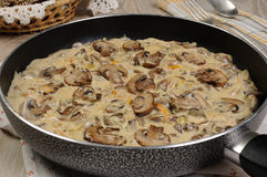 Fried mushrooms in a creamy sauce Stock Photo