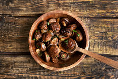 Fried mushrooms with onion Stock Images