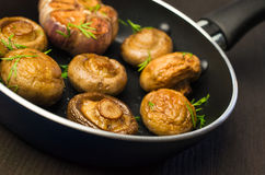 Fried mushrooms in a pan Royalty Free Stock Photography