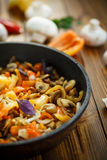 Fried mushrooms with peppers and onions Royalty Free Stock Photography