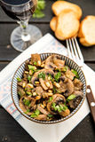 Fried mushrooms with pine nuts Royalty Free Stock Images