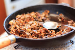Fried mushrooms in a skillet Royalty Free Stock Images