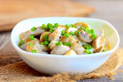 Fried mushrooms slices in a sour cream sauce. Tasty mushrooms with sour cream and green onions in a bowl. Healthy vegetarian dish Royalty Free Stock Photography