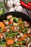 Fried mushrooms with vegetables in a pan vertical Stock Image