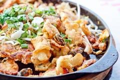 Fried mussel pancake in hot pan Stock Photos