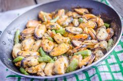 Fried mussels on the pan Royalty Free Stock Images
