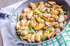 Fried mussels on the pan Stock Images