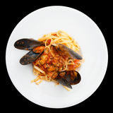 Fried mussels with pasta isolated on black Royalty Free Stock Image