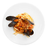 Fried mussels with pasta isolated on white Royalty Free Stock Photo