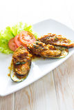 Fried mussels with tomatoes sauce Royalty Free Stock Images
