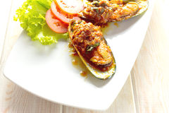 Fried mussels in tomatoes sauce Royalty Free Stock Images