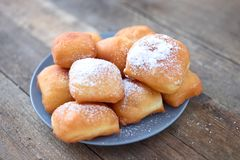 New Orleans Beignet. Fried New Orleans Beignets on a wooden background stock photo