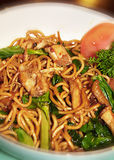 Fried noodle. Traditional fried noodle served with vegetable and duck meat Stock Photography