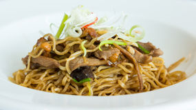 Fried noodle with abalone sauce and BBQ duck Royalty Free Stock Photography