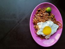 Fried noodle. With fried egg served on plate royalty free stock images
