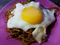 Fried noodle. With fried egg served on plate stock images