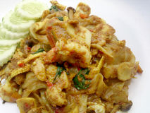 Fried noodle with Green Curry and Shrimp in padthai style, Thai food. Stock Photo