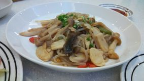Fried noodle with mushroom. Yum Japanese menu,  seasoning with shoyu sauce Stock Images