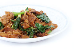 Fried noodle with pork. On dish in lsolated shot stock photo