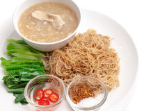 Fried noodle with pork and chinese kale served with chili sauce Stock Image