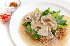 Fried noodle with pork and chinese kale served with chili sauce Royalty Free Stock Photography
