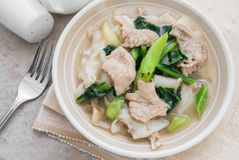 Fried noodle with pork and kale soaked in gravy Royalty Free Stock Images