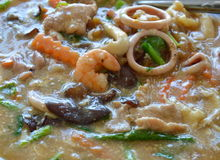 Fried noodle with pork and seafood in gravy sauce on dish Royalty Free Stock Photography