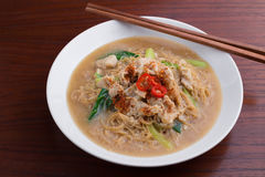 Fried noodle with pork and vegetable. Thai-Chinese noodle dish `Rad Na` Royalty Free Stock Photos