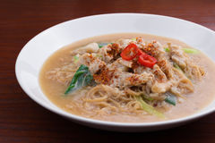 Fried noodle with pork and vegetable. Thai-Chinese noodle dish `Rad Na` Stock Photography