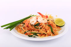 Fried noodle Thai style with prawns, Stir fry noodles with shrimp in padthai style on table. Front view isolate white , brown   ba Stock Photography