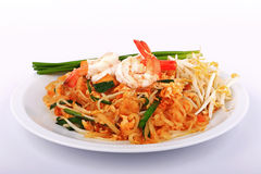 Fried noodle Thai style with prawns, Stir fry noodles with shrimp in padthai style on table. Front view isolate white , brown   ba Stock Images