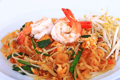 Fried noodle Thai style with prawns, Stir fry noodles with shrimp in padthai style on table. Front view isolate white , brown   ba Royalty Free Stock Image