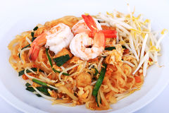 Fried noodle Thai style with prawns, Stir fry noodles with shrimp in padthai style on table. Front view isolate white , brown   ba Royalty Free Stock Images