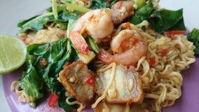 Fried-noodle. ThaiFood crispy-pork-with-kale shrimps vegetable lunch hot stock images